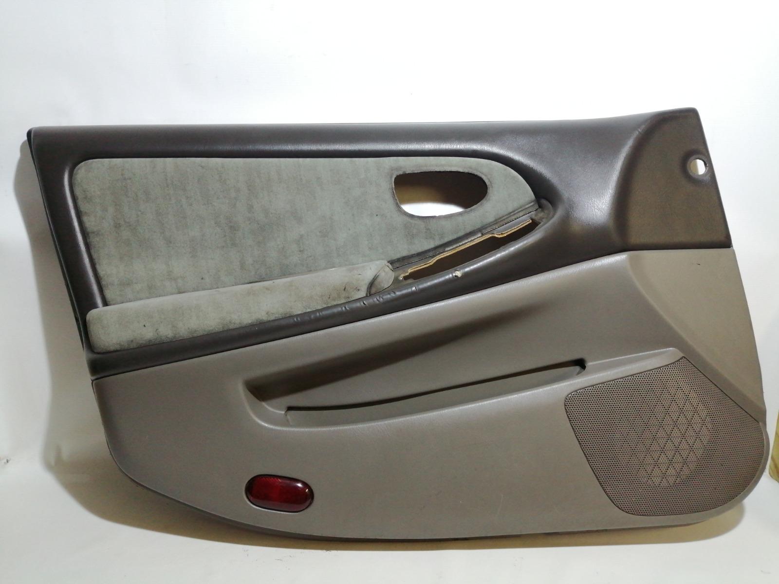 Обшивка двери Nissan Cefiro A33 VQ20DE 1999 передняя левая