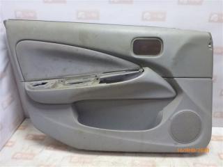 Обшивка двери передняя левая Nissan Almera 2001