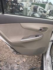 Обшивка дверей задняя левая Toyota Corolla Axio 2008
