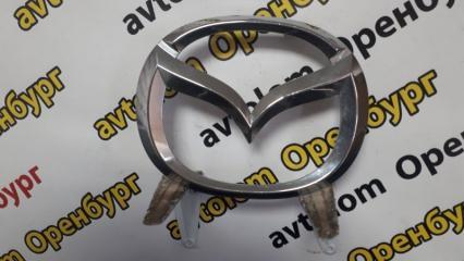 Запчасть эмблема передняя Mazda 6