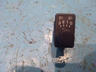 Запчасть кнопка корректора фар Nissan Primera