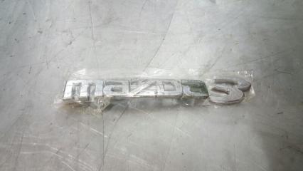 Запчасть эмблема задняя Mazda Mazda3 2006-2009