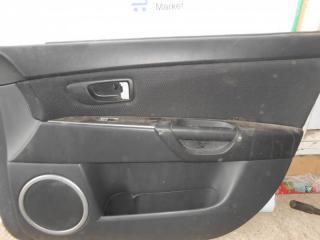 Запчасть обшивка двери передняя правая Mazda 3 2007