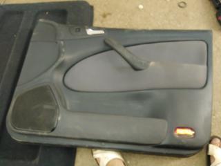 Запчасть обшивка двери передняя правая Skoda Octavia 2004