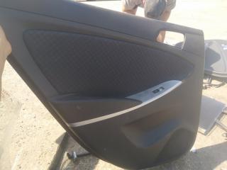 Запчасть обшивка двери задняя левая Hyundai Solaris 2013