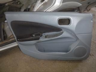 Запчасть обшивка двери передняя левая Nissan Almera 2006
