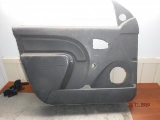 Запчасть обшивка двери передняя левая Renault Logan 2009
